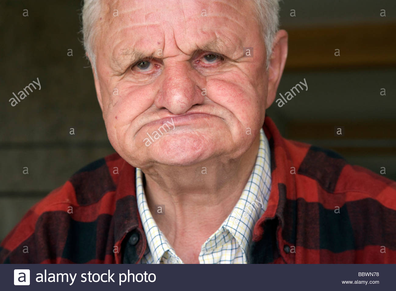 face of elderly 80 plus years man without teeth - Stock Image