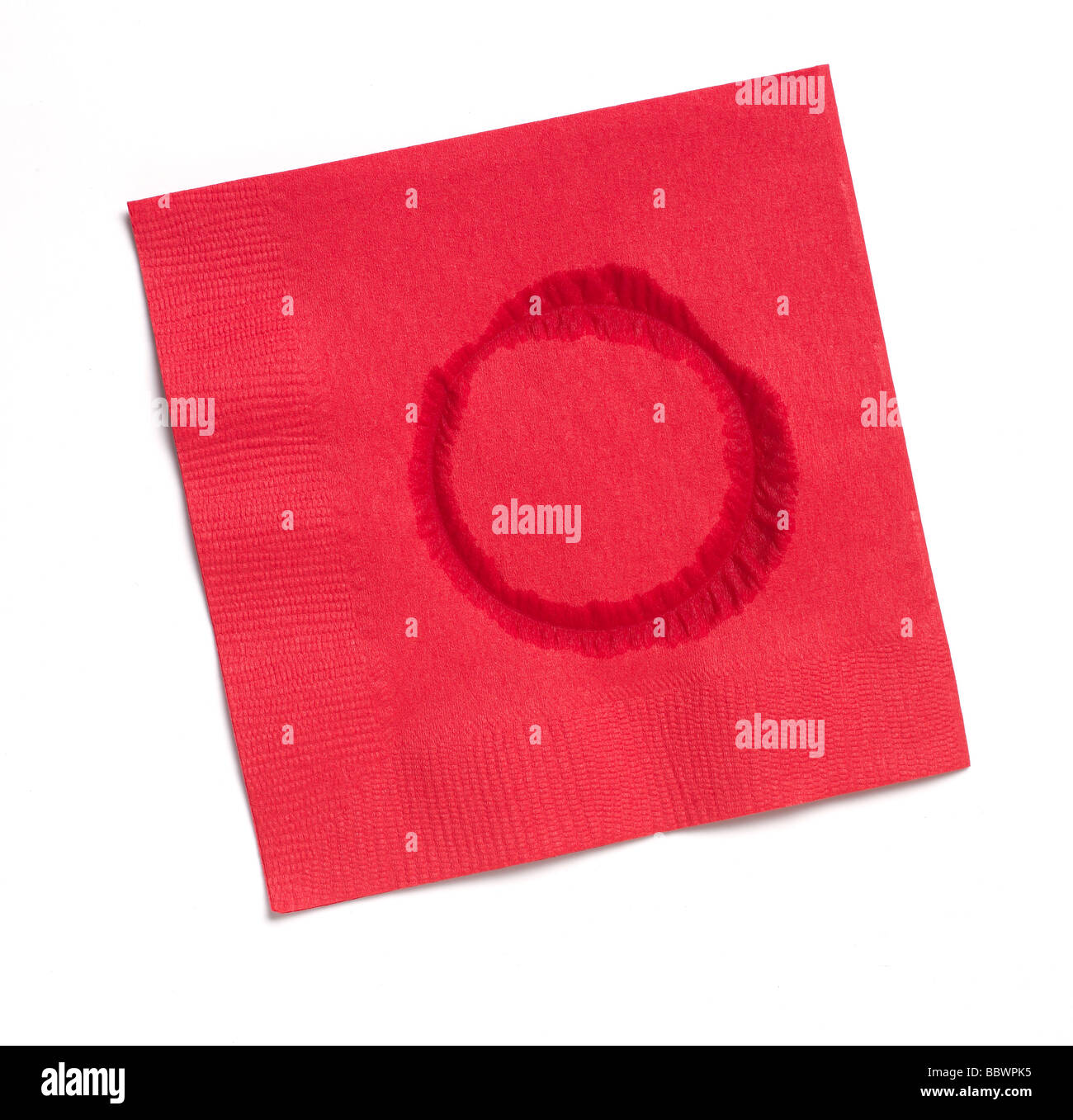 Red Paper napkin with water ring - Stock Image