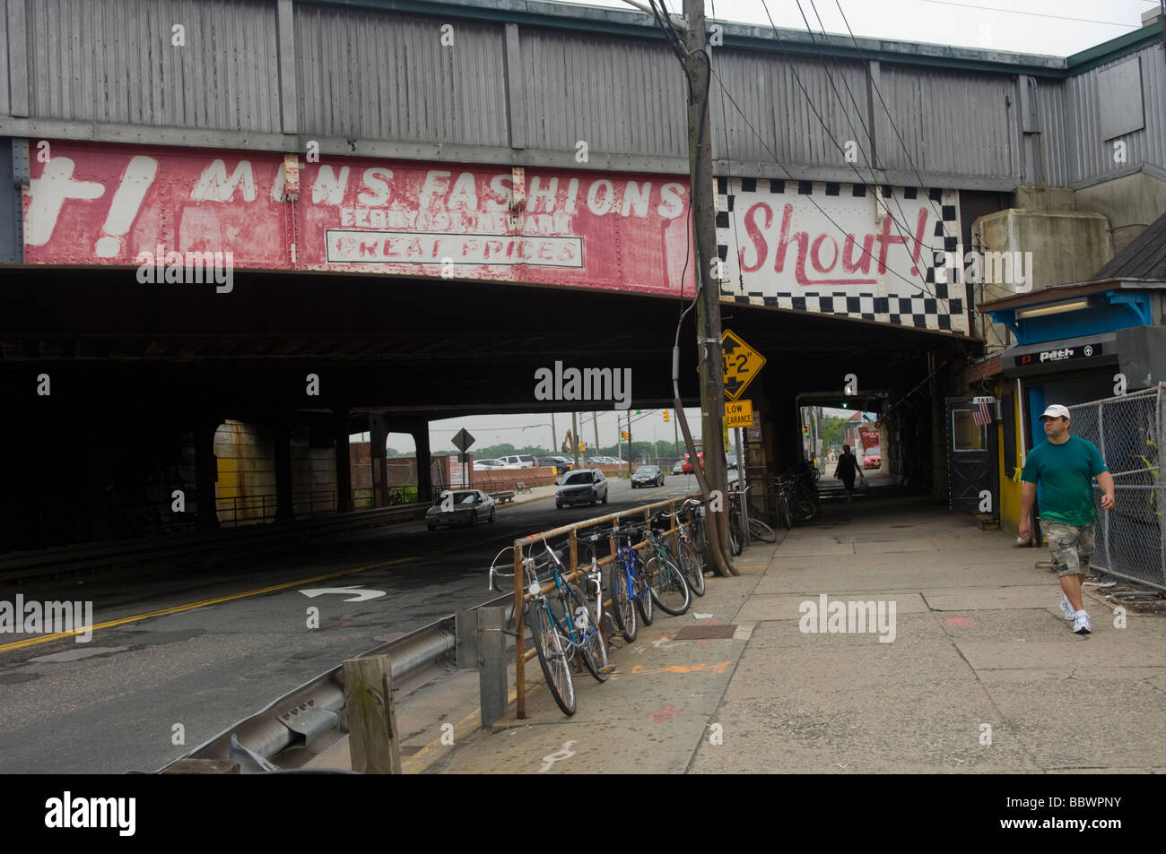 Fading advertisements on a train overpass in Harrison New Jersey on June 10 2009 Frances M Roberts - Stock Image