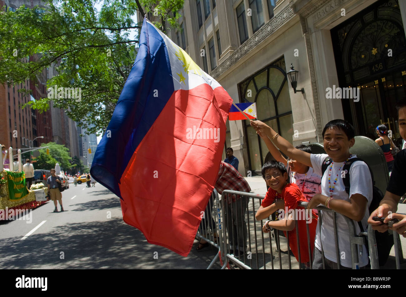 Filipino Americans from the tri state area march in the Philippines Independence Day Parade on Madison Ave in New - Stock Image