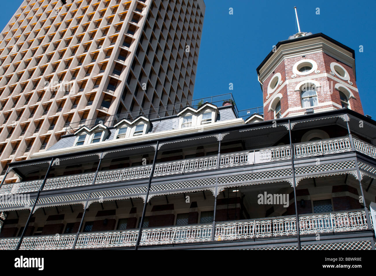 People's Palace Hotel (Heritage Building) contrasting with a modern high rise block, Brisbane Queensland Australia - Stock Image
