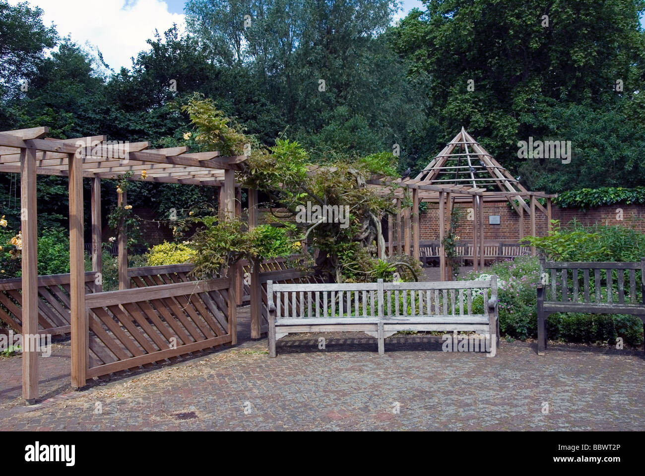 Empty Bench in a English Garden - Stock Image