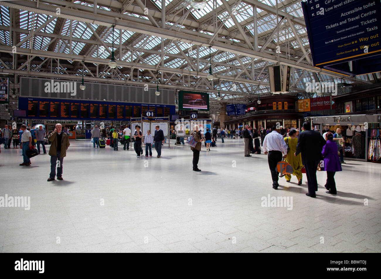 Travellers in the concourse of Glasgow Central station, Scotland's busiest station, UK - Stock Image