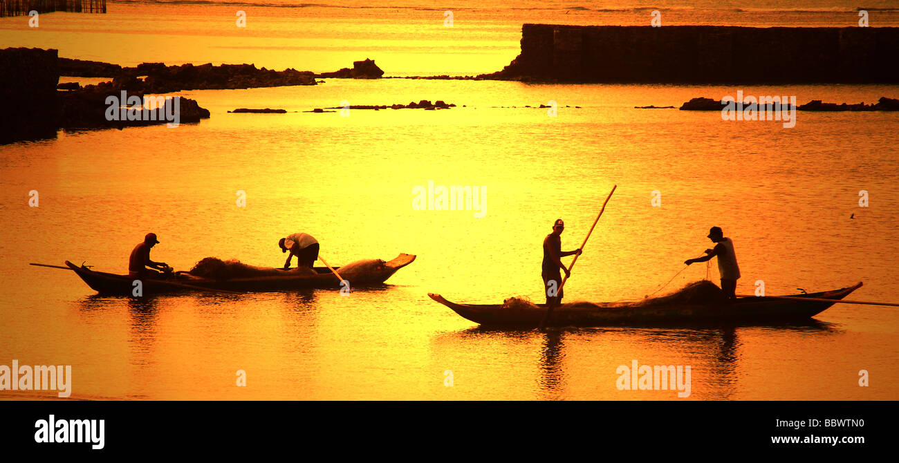 people using canoes at alagoas sunset brazil Stock Photo