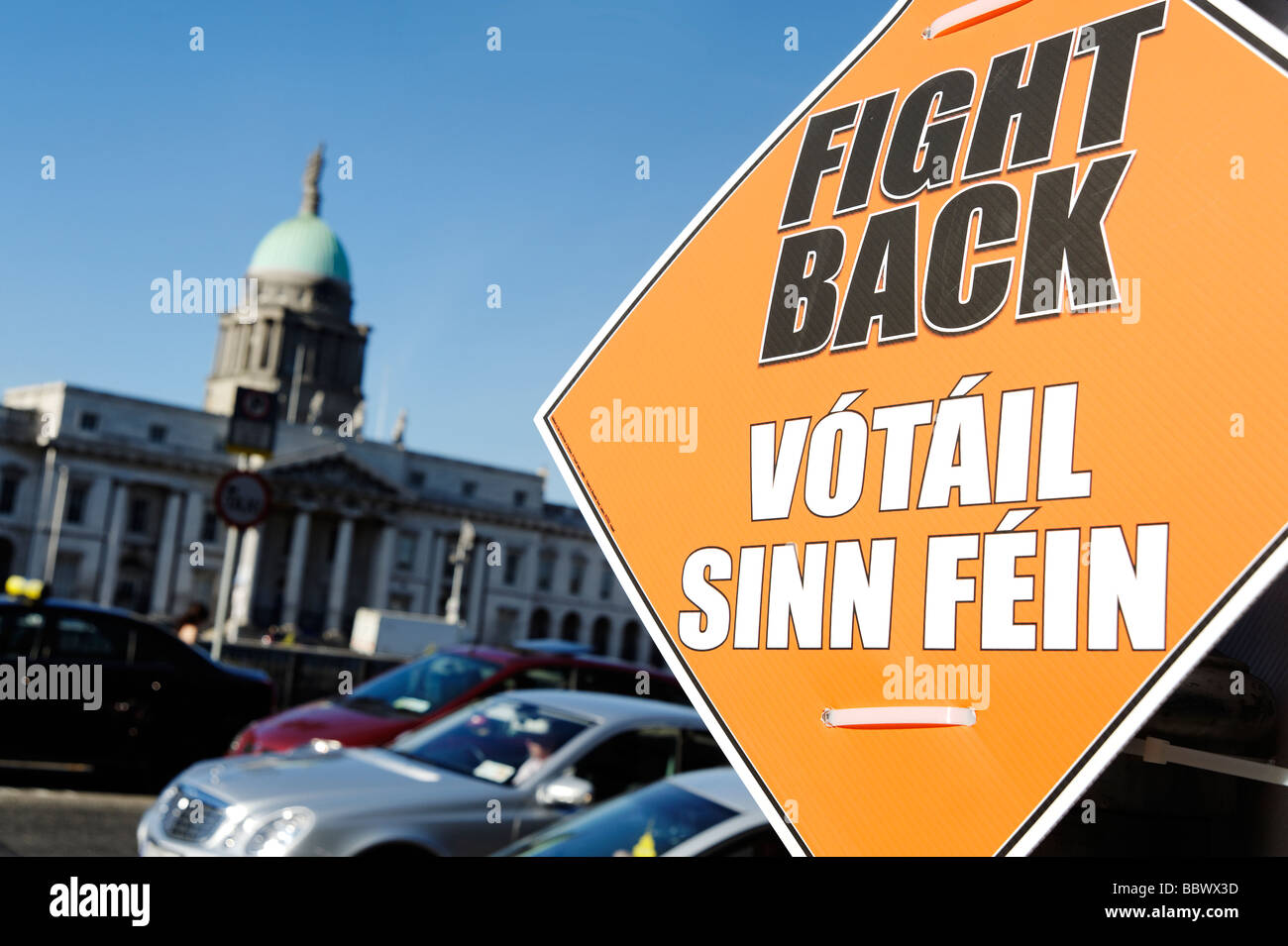 Sinn Fein election campaign poster in front of the Custom House building in central Dublin Republic of Ireland - Stock Image