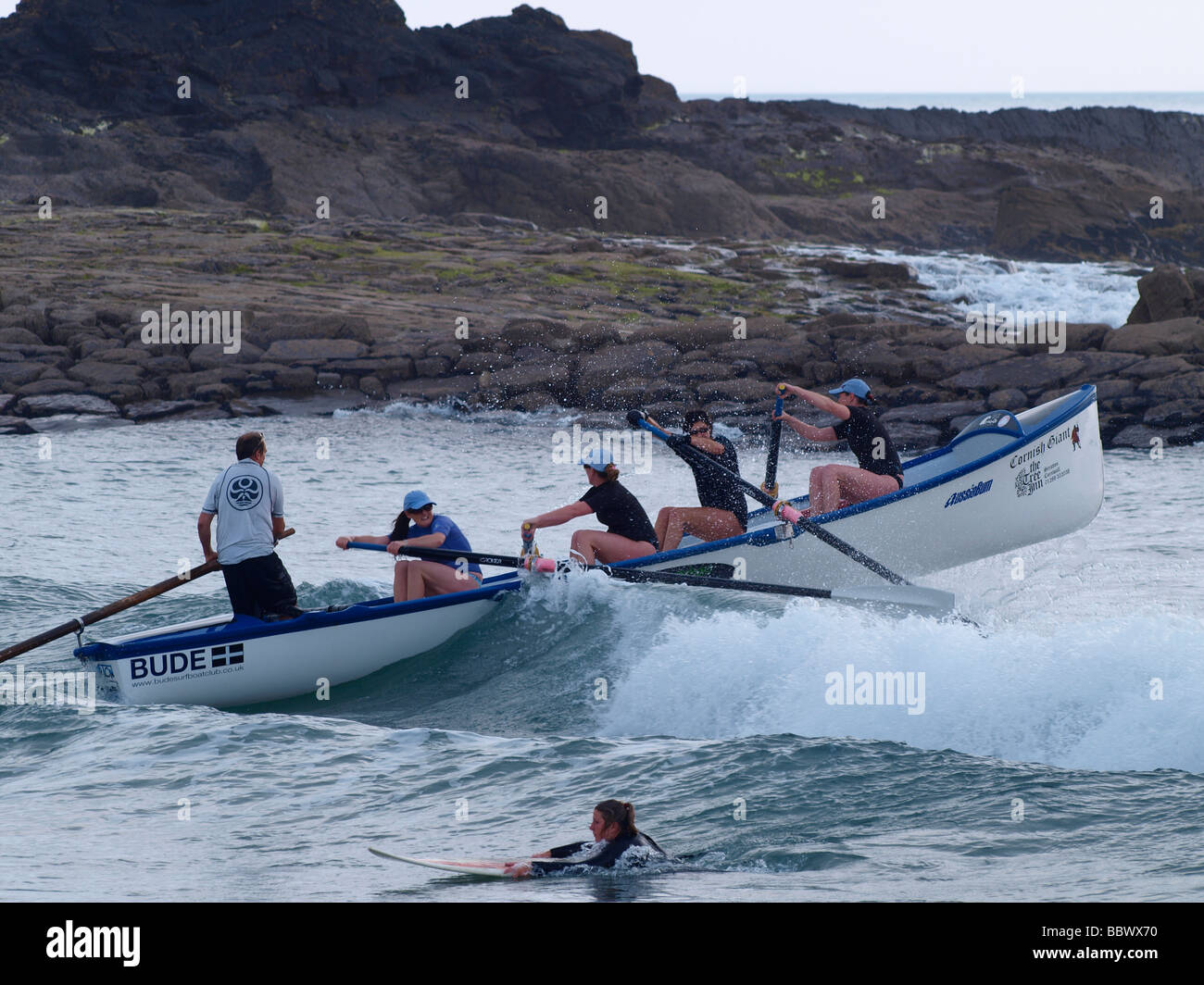 Gig boat team battling through waves - Stock Image