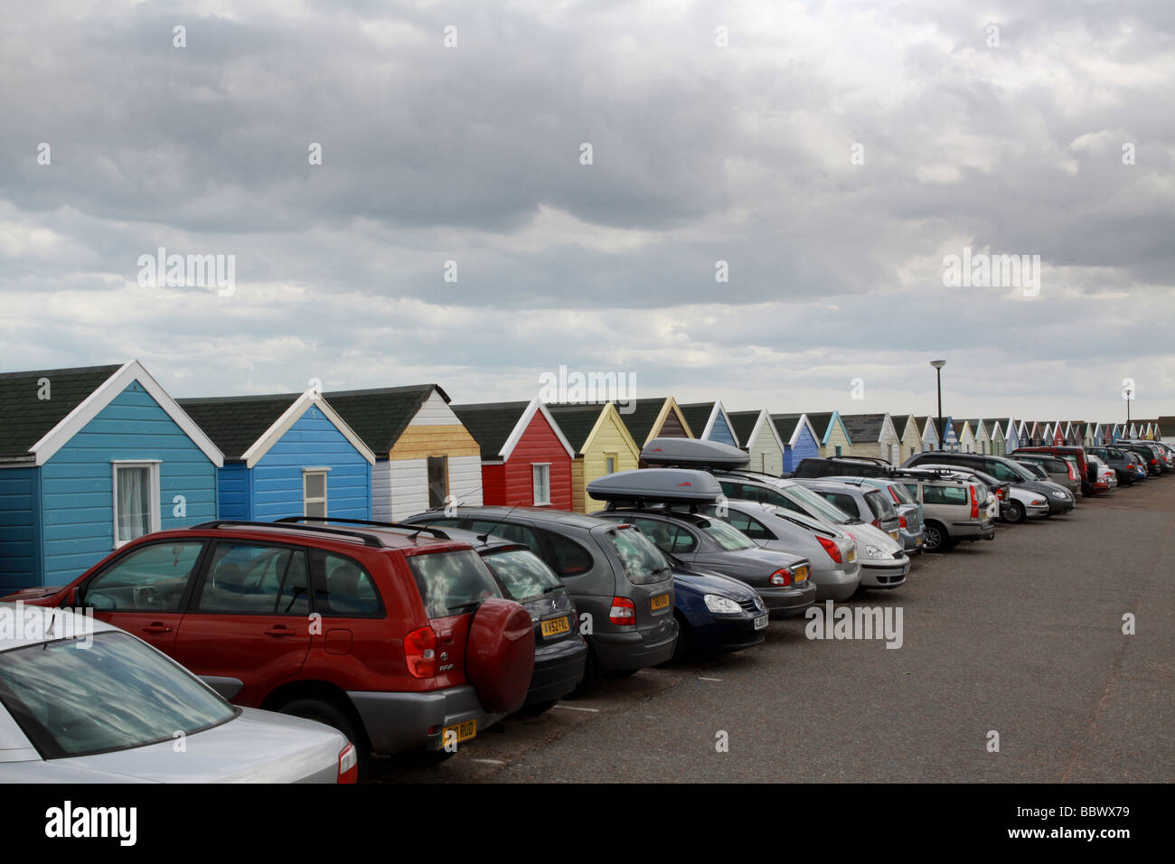 illustration or concept of the pressure on english coastal areas with the numbers of visitors showing here by a - Stock Image