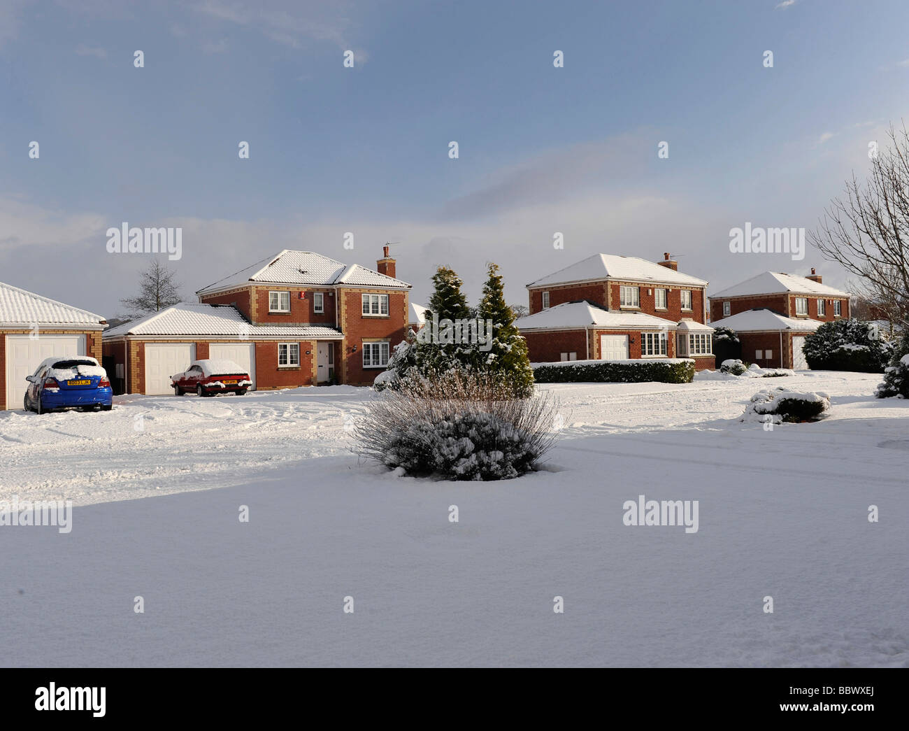 Residential surburban street in Great Britain covered in fresh snow fall - Stock Image