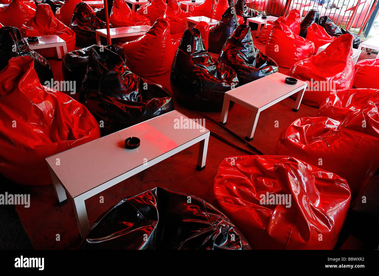Room with beanbag chairs as seats to relax, bar for smokers of Turkish water pipes, Narghile, Istanbul, Turkey - Stock Image