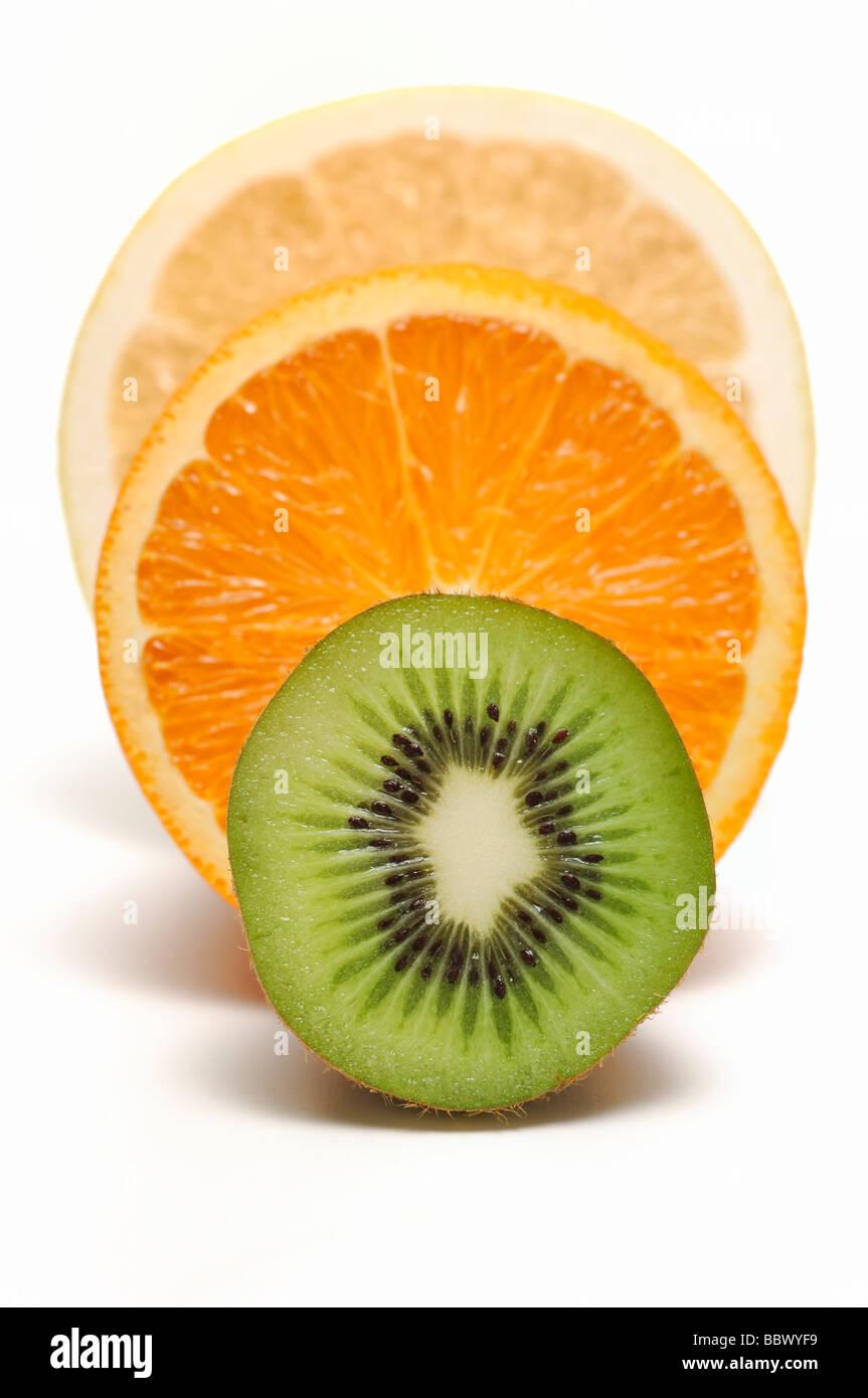 Half Cut of Kiwi Fruit, Orange and Grapefruit - Stock Image