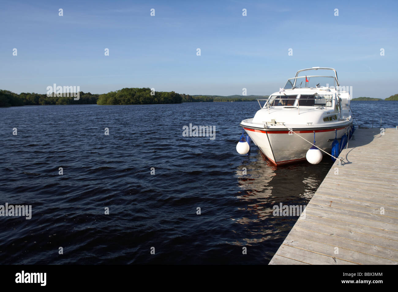 cabin cruiser moored at jetty on lower lough erne county fermanagh northern ireland uk - Stock Image