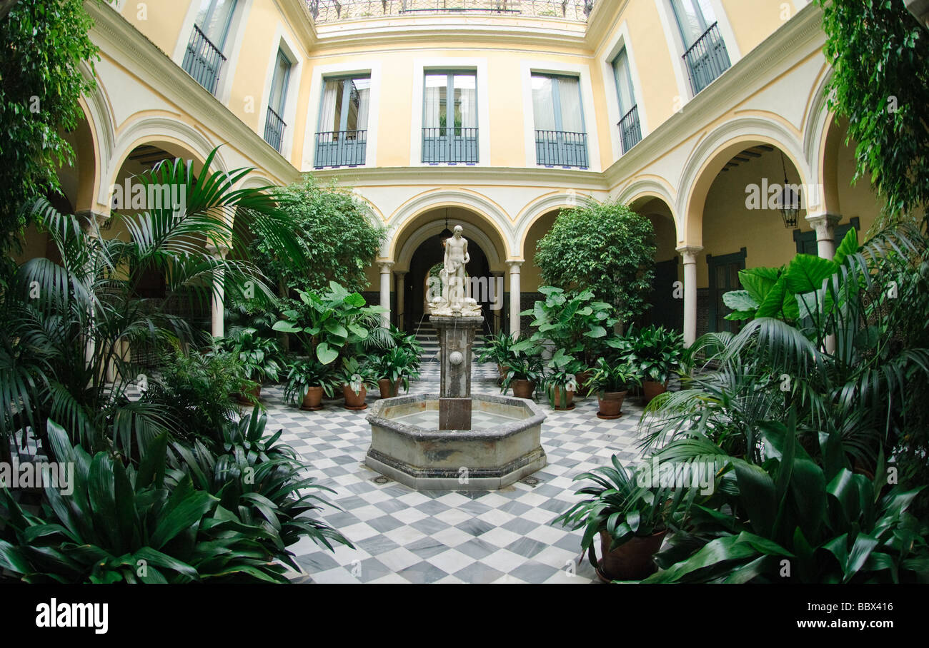 interior courtyard with fountain in Sevilla Andalucia Spain - Stock Image