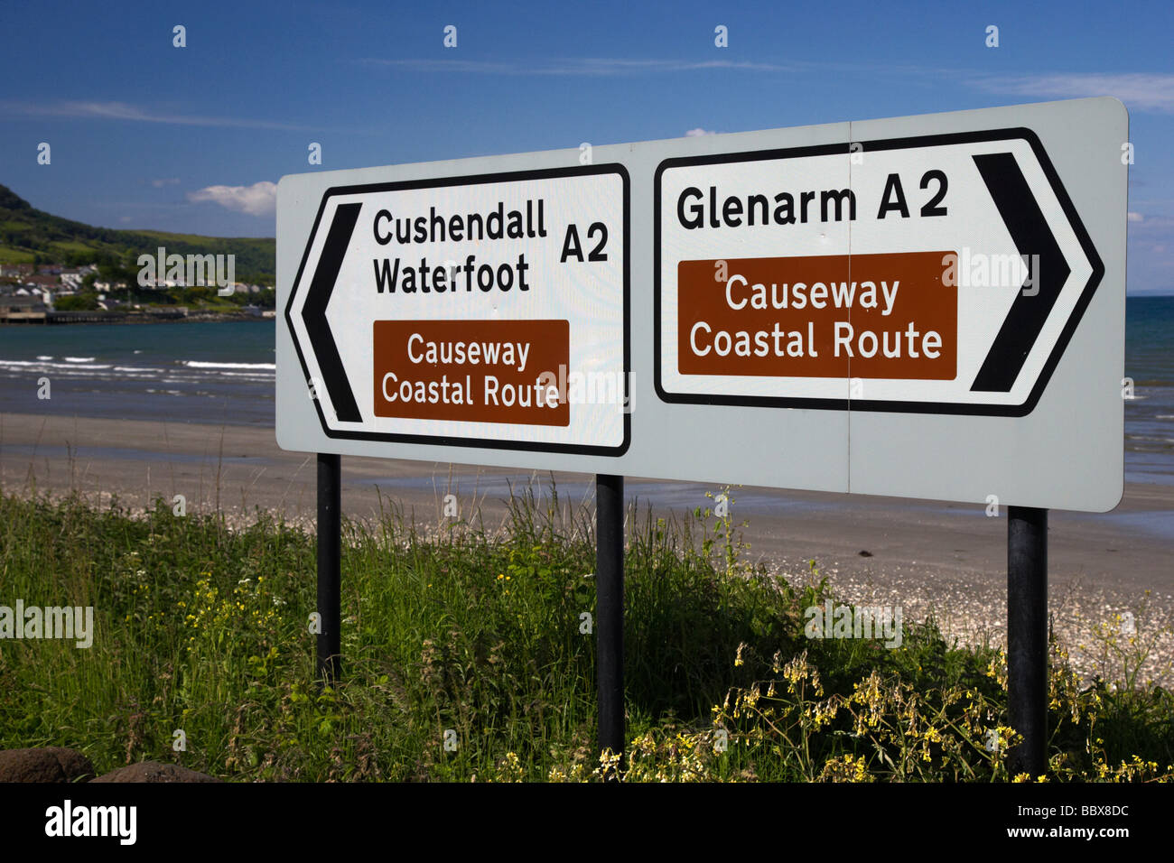 signposts for the causeway coastal route at carnlough between cushendall and glenarm county antrim coast road A2 - Stock Image