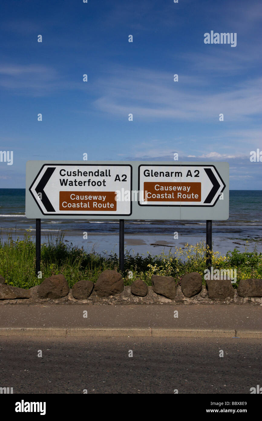 signposts for the causeway coastal route at carnlough between cushendall and glenarm county antrim coast road A2 Stock Photo