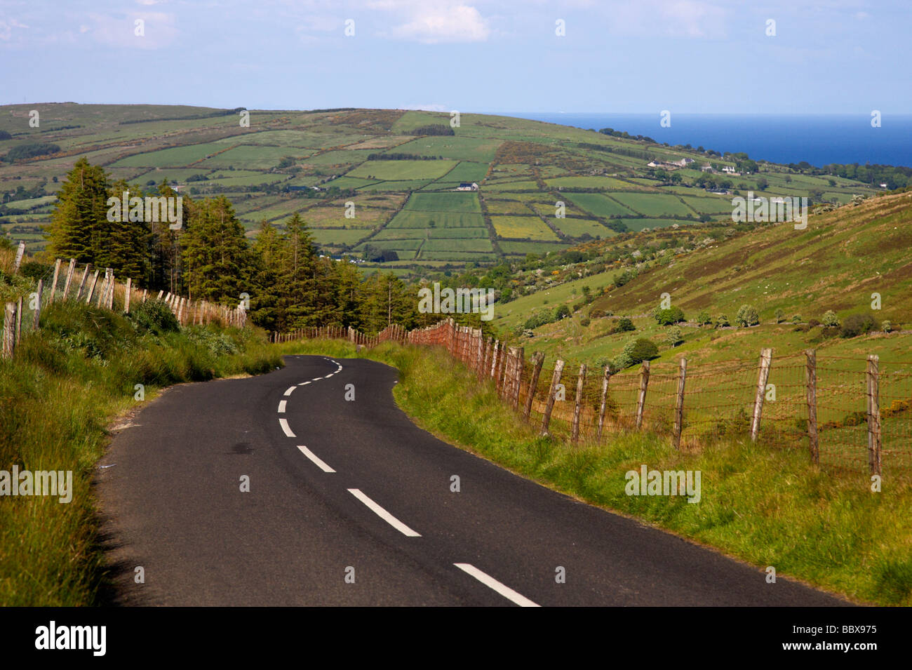 twisty country mountain road through glenaan scenic route glenaan county antrim northern ireland uk - Stock Image