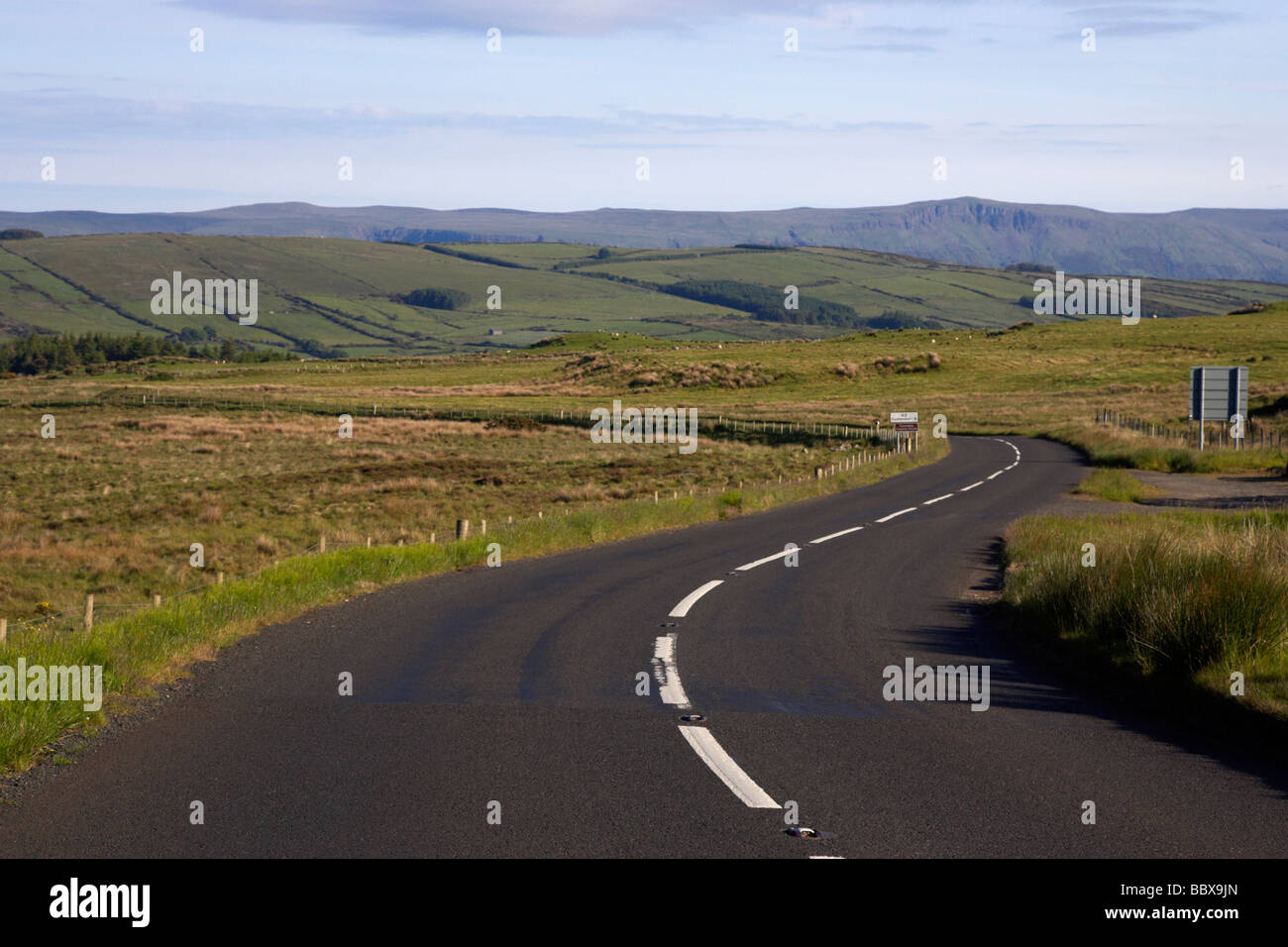 twisty bendy antrim coastal road route over mountains on the antrim plateau county antrim northern ireland uk Stock Photo