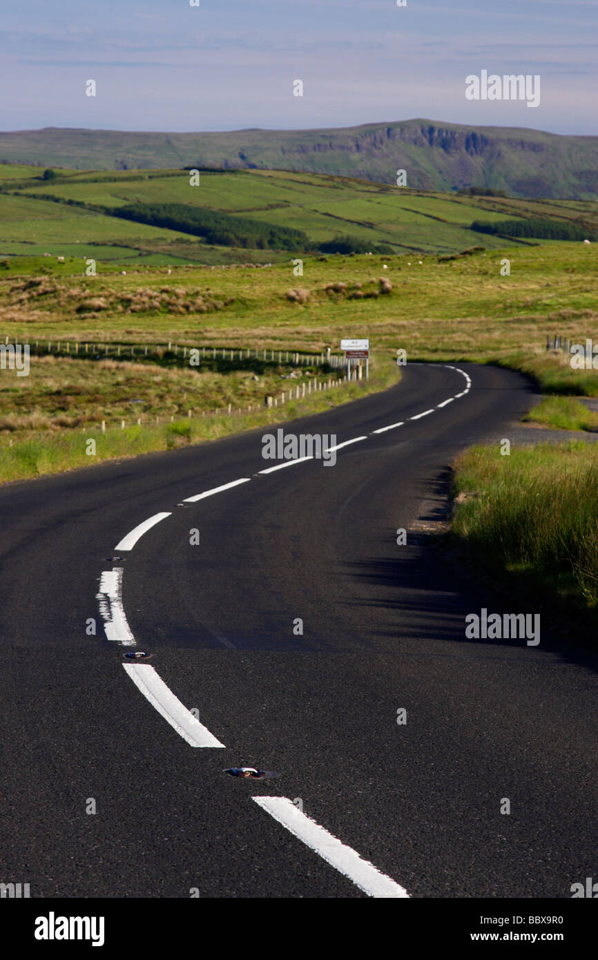 twisty bendy antrim coastal road route over mountains on the antrim plateau county antrim northern ireland uk - Stock Image