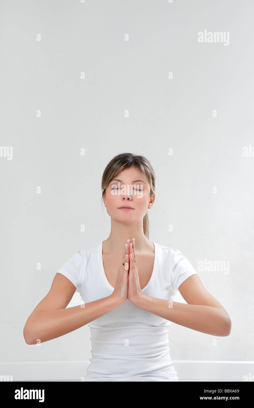 young woman doing yoga indoors Copy space - Stock Image