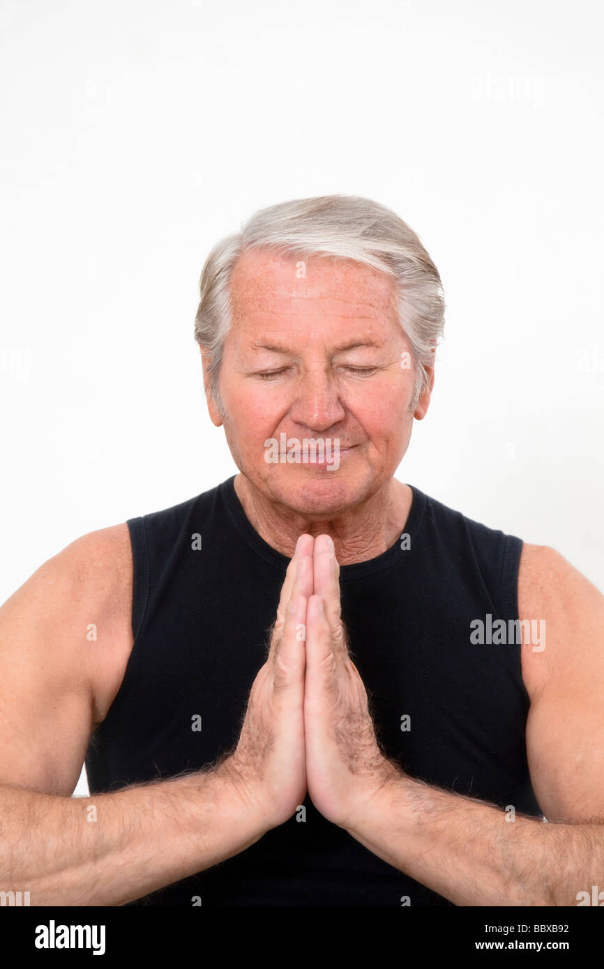 senior man doing yoga indoors Copy space - Stock Image