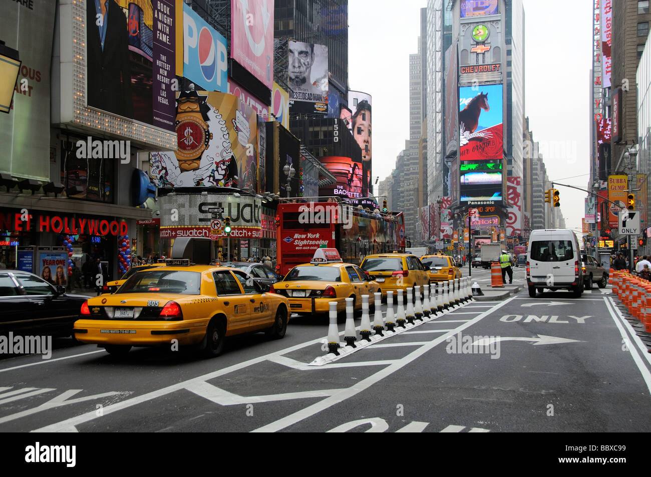 New York Sightseeing Bus And Yellow Cabs Traffic On Broadway Times Square USA