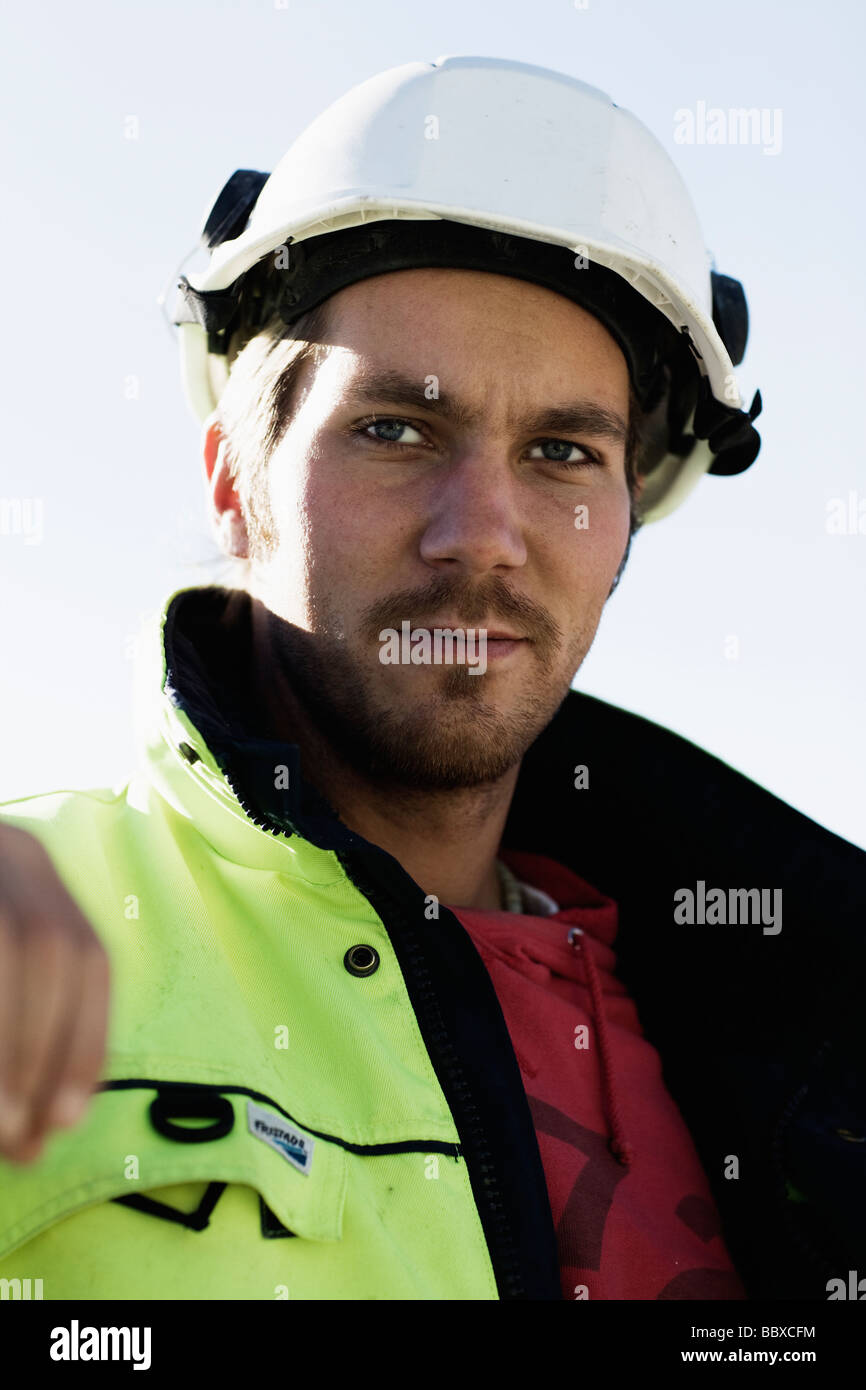 A building worker at a building site Sweden. - Stock Image