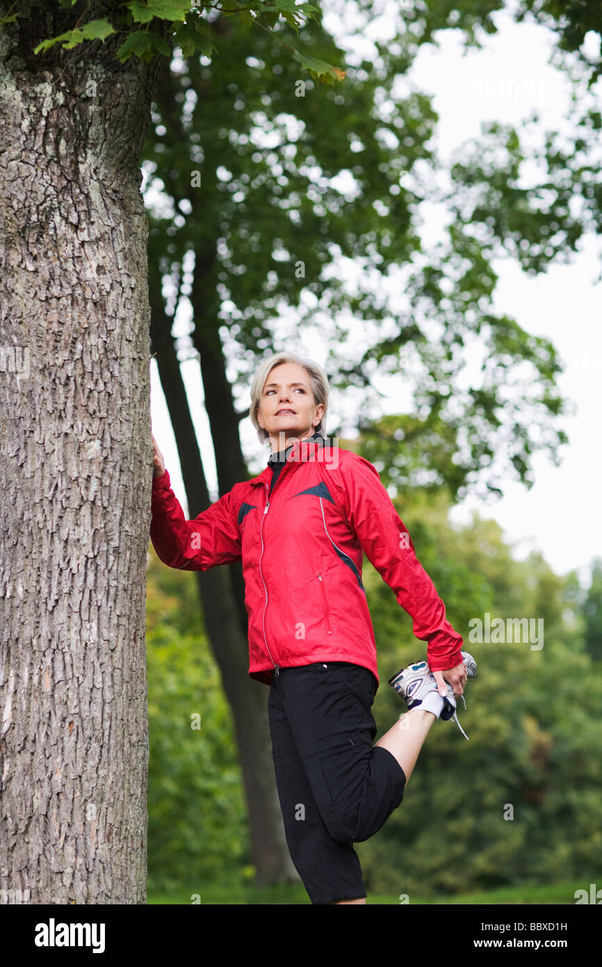 A woman doing stretching exercises Stockholm Sweden. Stock Photo