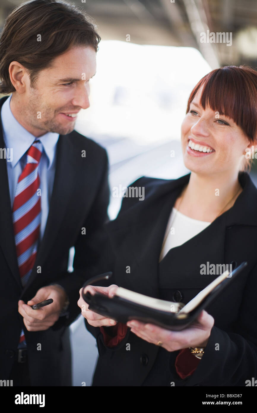 Two business people on a train station Stockholm Sweden. - Stock Image