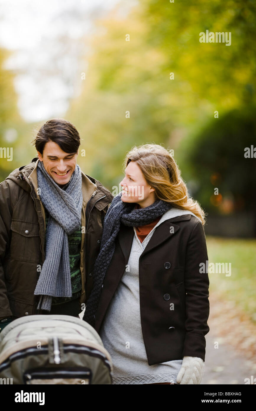 A couple taking a walk with their baby Sweden. - Stock Image