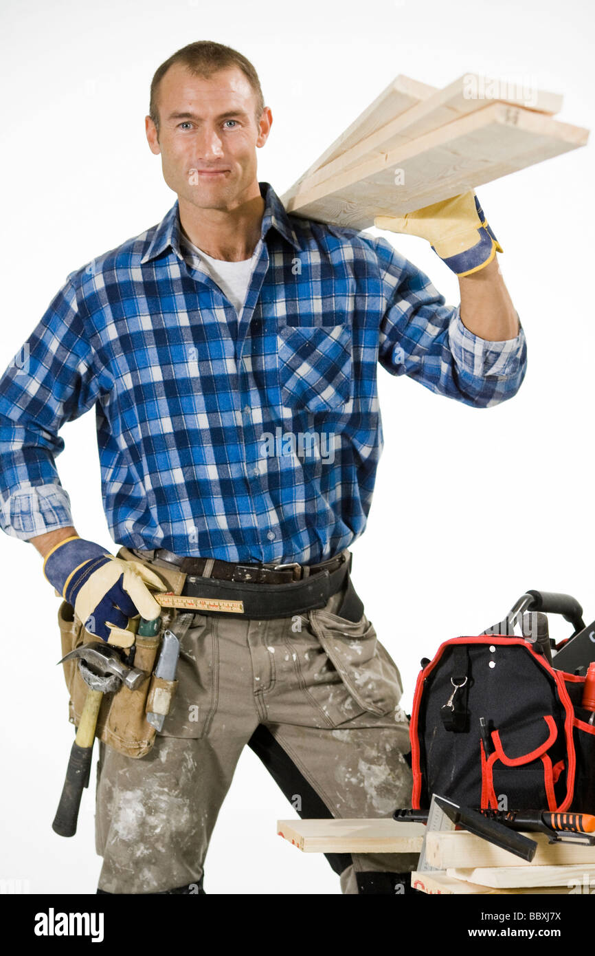 A carpenter with plank and tolls. - Stock Image