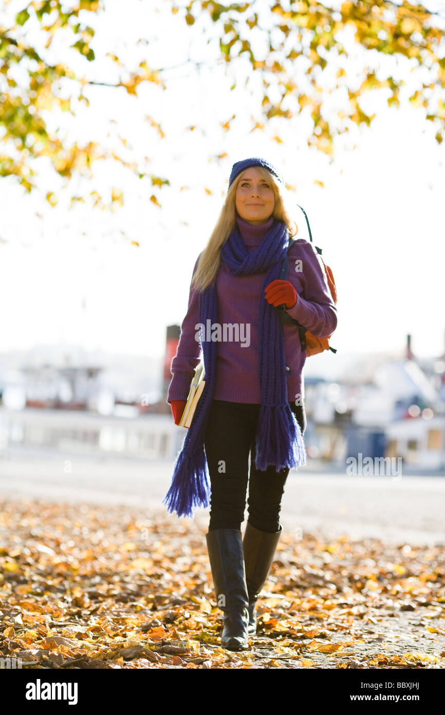 Young female student taking a walk in autumn Stockholm Sweden. Stock Photo