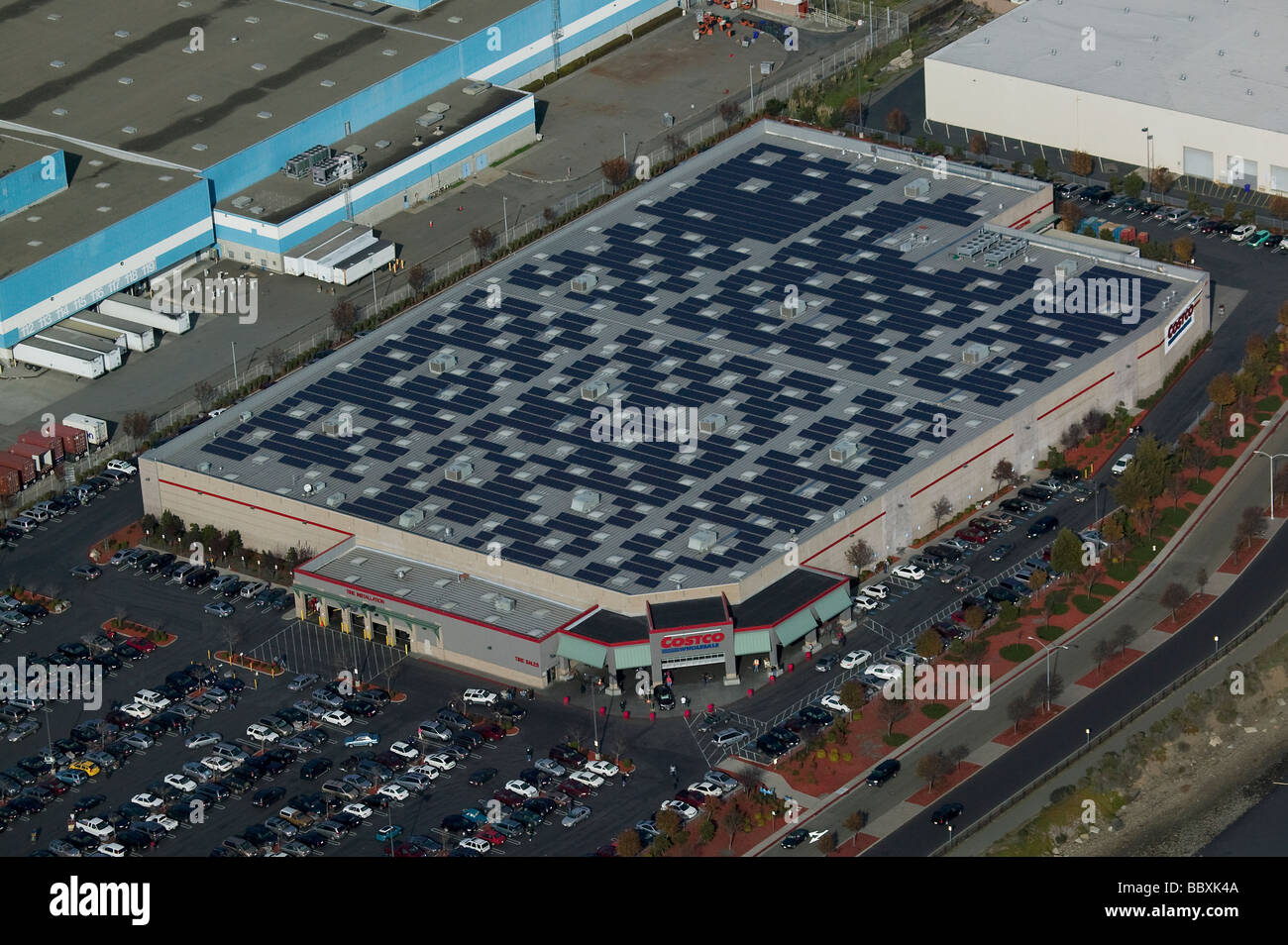 aerial view above solar power panels Costco warehouse rooftop Richmond California - Stock Image