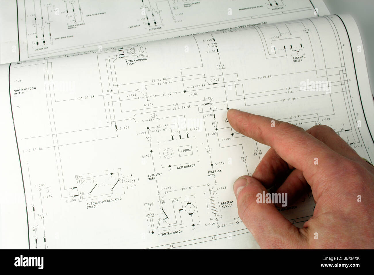 man referring to electrical wiring diagram - Stock Image