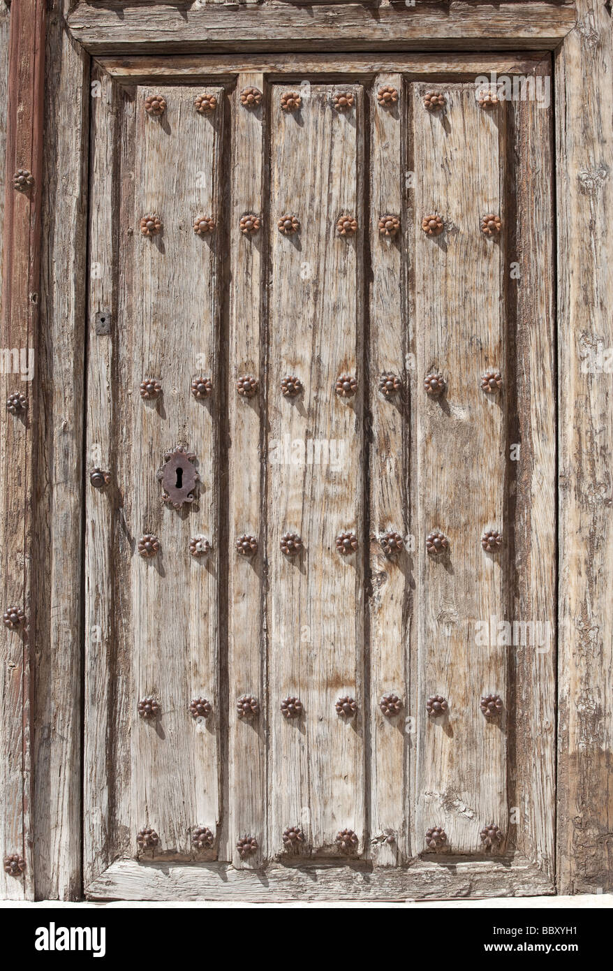 Detail of weathered door with keyhole - Stock Image