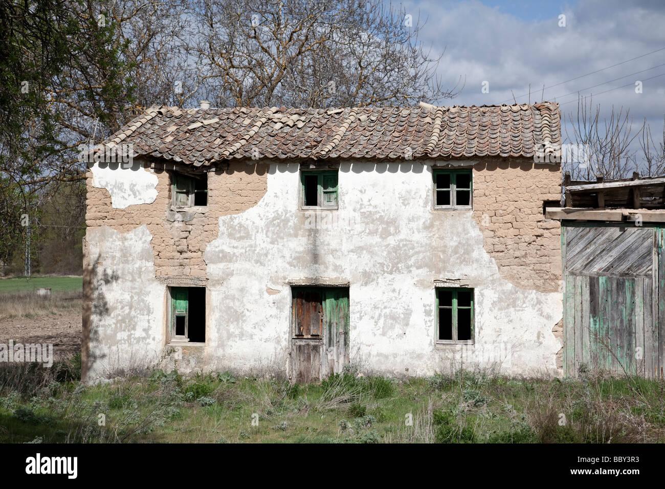 derelict farmhouse - Stock Image