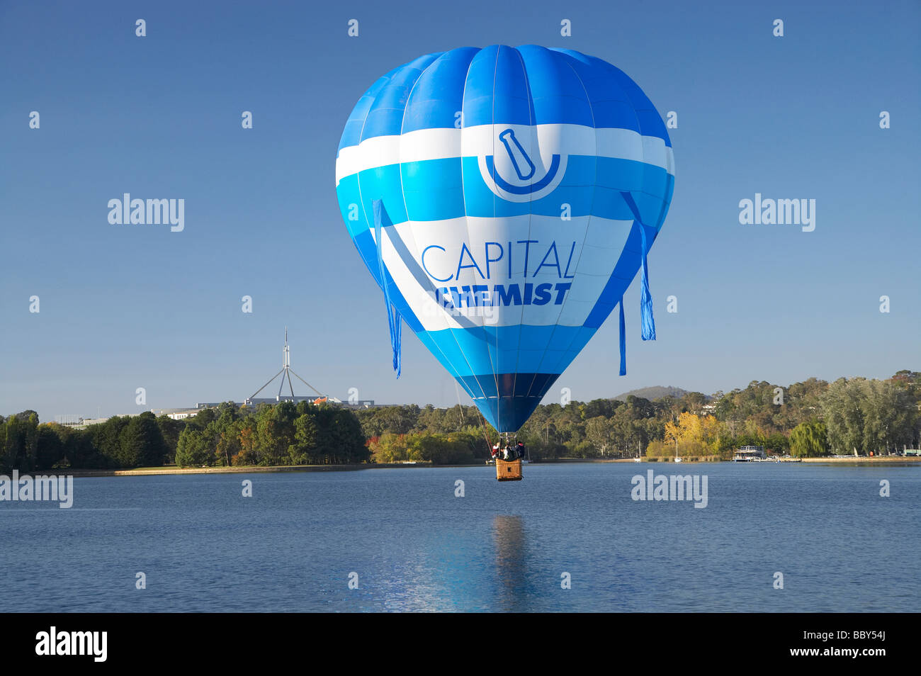 Hot Air Balloon Lake Burley Griffin and Flagpole on Parliament House Canberra ACT Australia - Stock Image