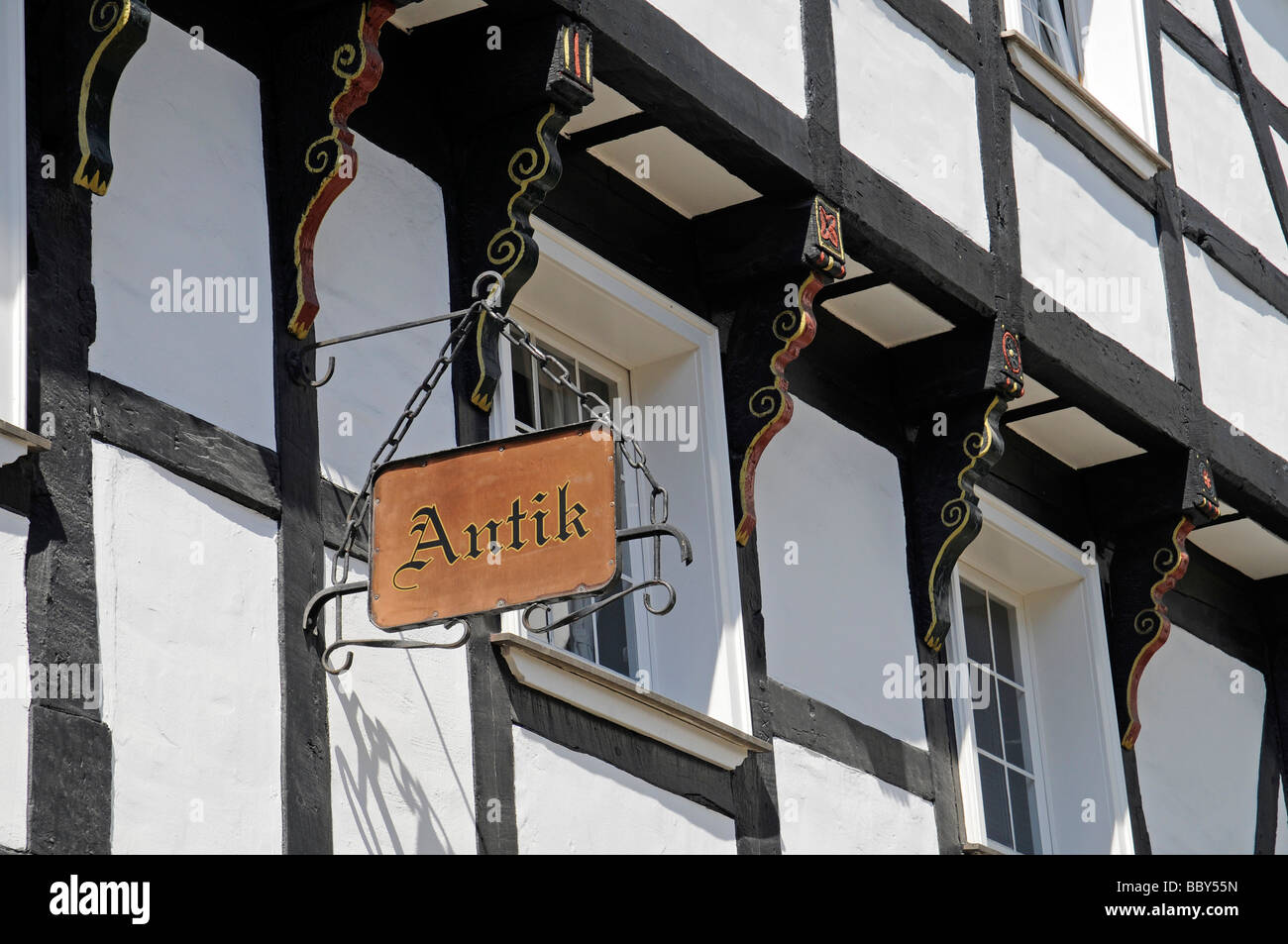 Wrought iron sign, Antik, half-timbered houses, historic town, Hattingen, North Rhine-Westphalia, Germany, Europe - Stock Image