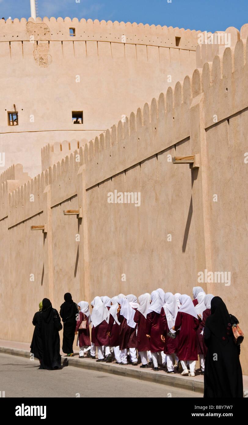 Schoolgirls in front of the Nizwa fort Sultanate of Oman - Stock Image