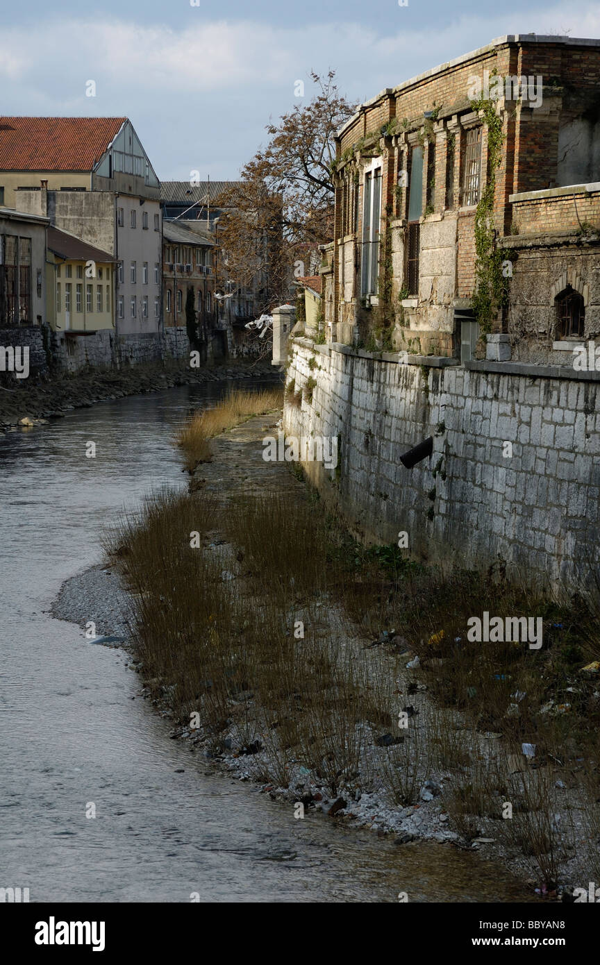 Polluted river channel of Rjecina passing through industrial part of Rijeka city - Stock Image