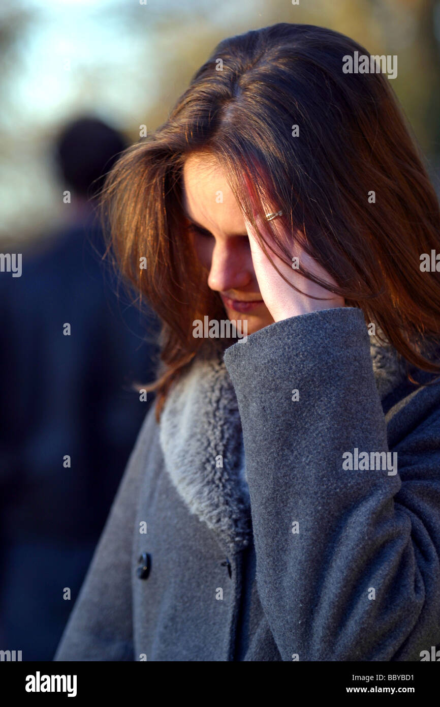 Splitting up outside young couple, the woman is upset - Stock Image