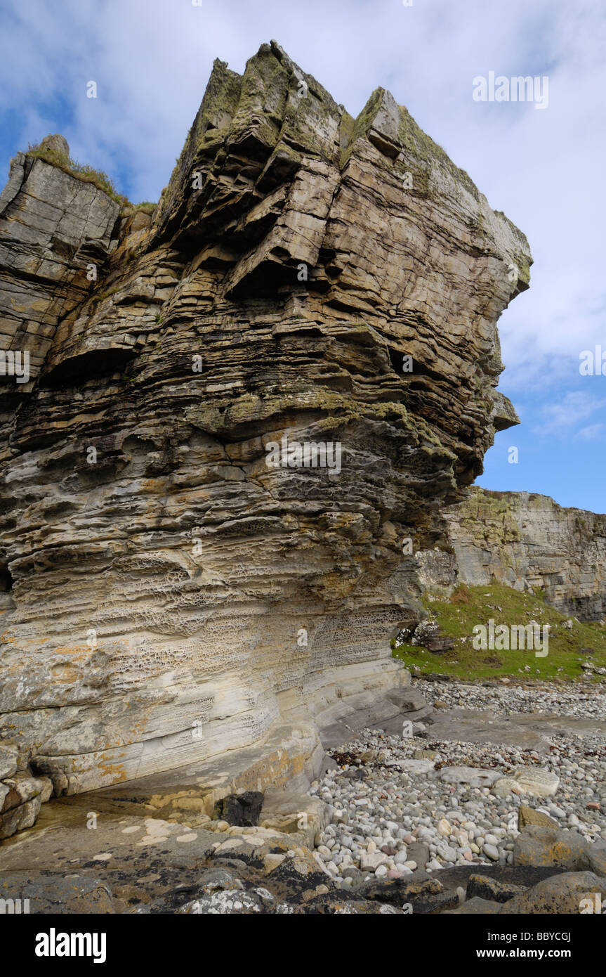 Eroded sandstone cliff along the shore at Elgol, Isle of Skye, Scotland - Stock Image