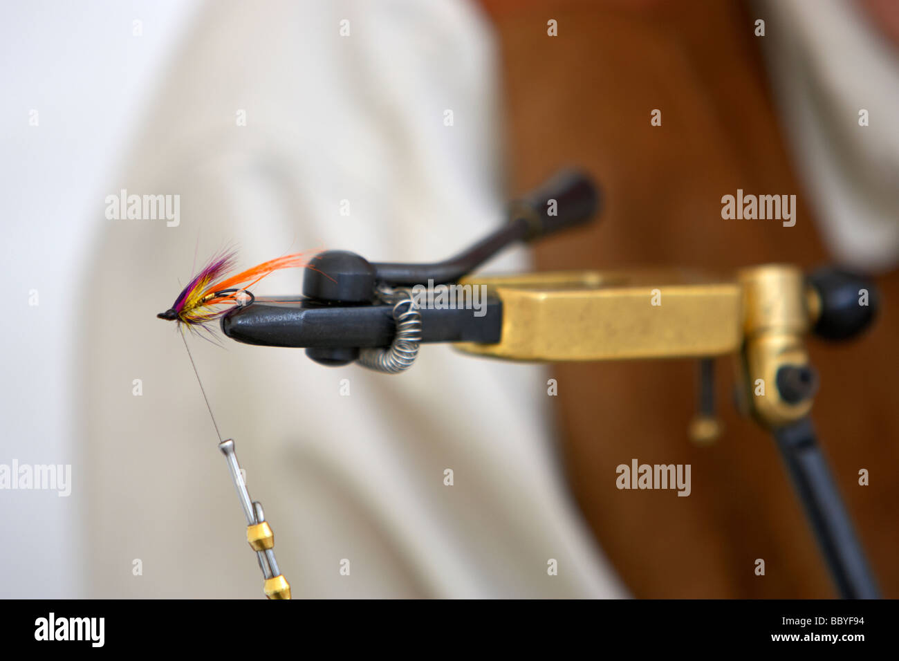 fly tying with fly in vice - Stock Image