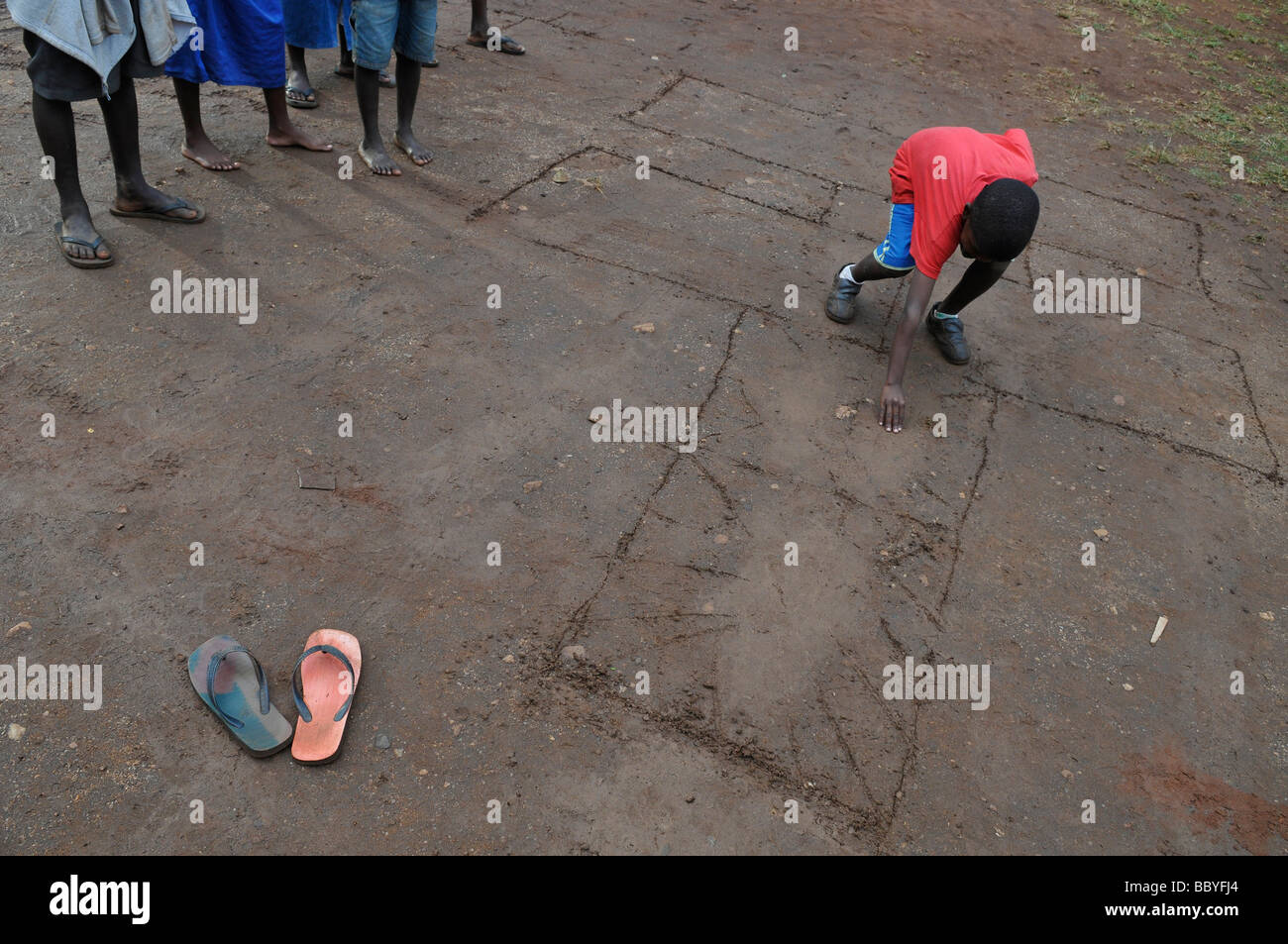 Young children playing hopscotch game in playground. Africa - Stock Image