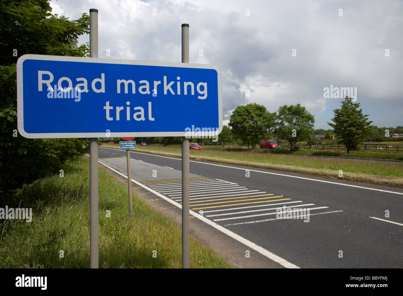 road marking trial roadsign and markings on dual carriageway county antrim northern ireland uk - Stock Image