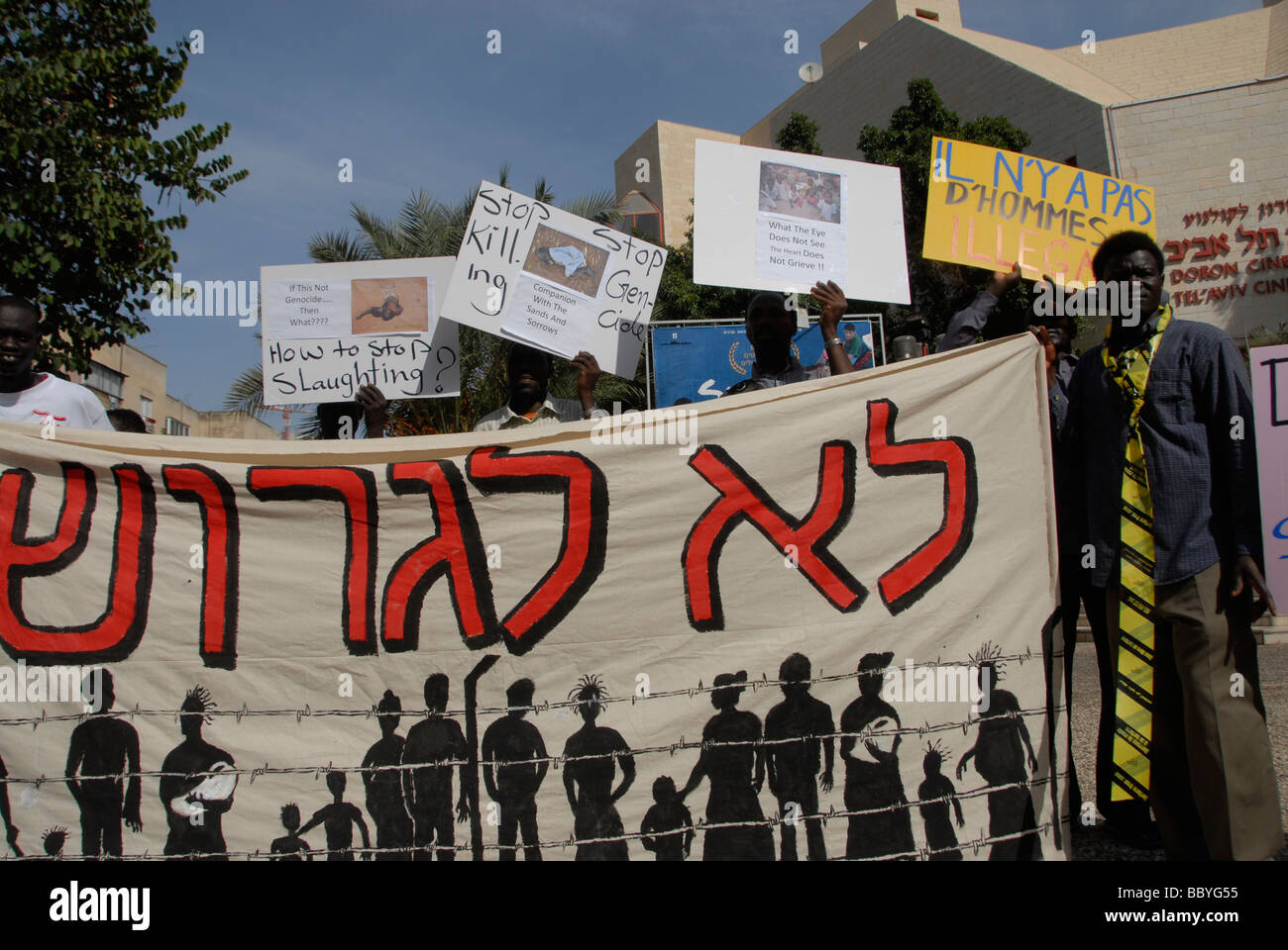African migrants holding a placard in Hebrew which reads 'No to Expulsion'  during a demonstration against - Stock Image