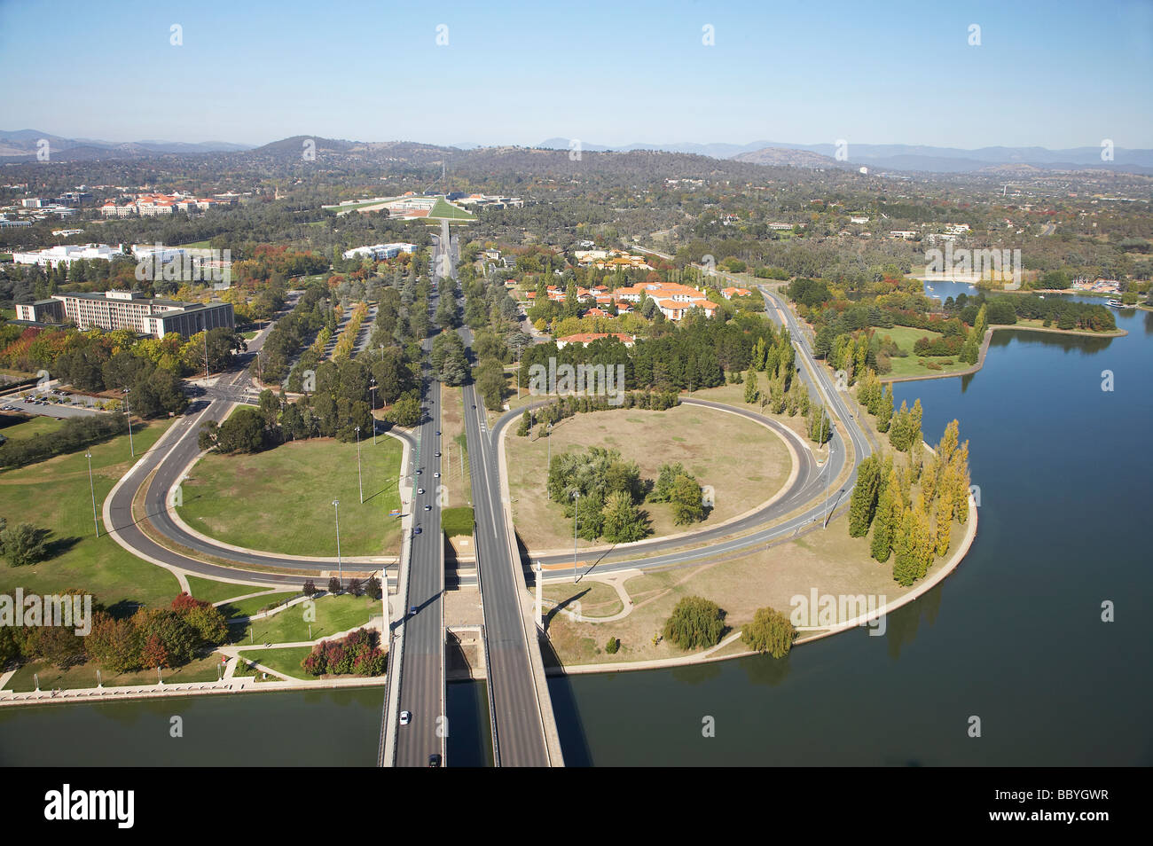 Commonwealth Avenue leading to Parliament House and Capital Hill and Lake Burley Griffin Canberra ACT Australia - Stock Image