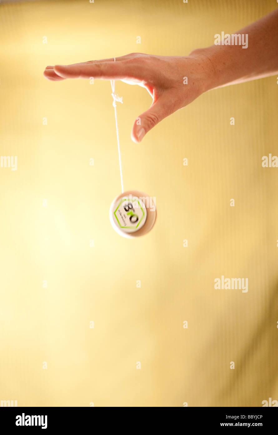 EU Biologo Hand playing with yoyo with an EU Eco logo Stock Photo