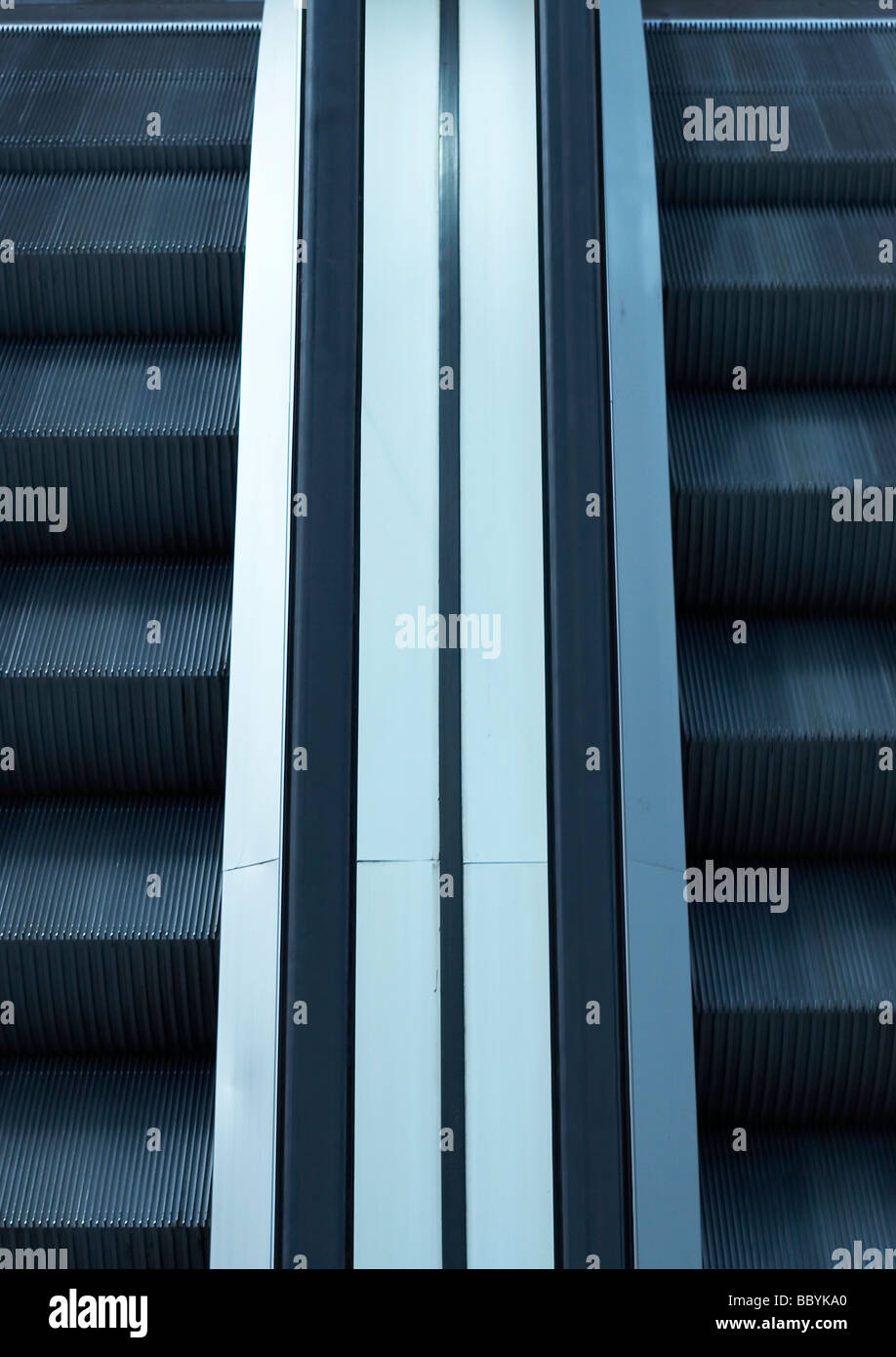 Semi-abstract image looking down on an escalator - Stock Image