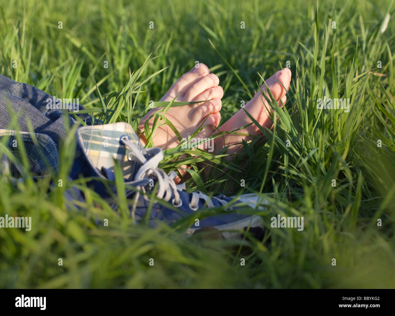 Young woman barefoot - Stock Image