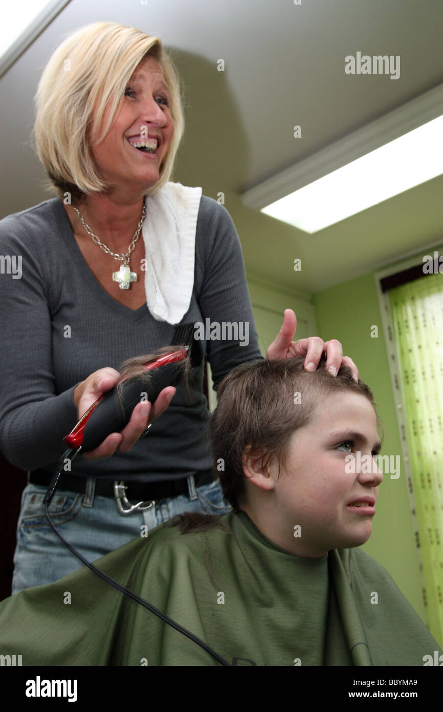 Kid getting a haircut - Stock Image