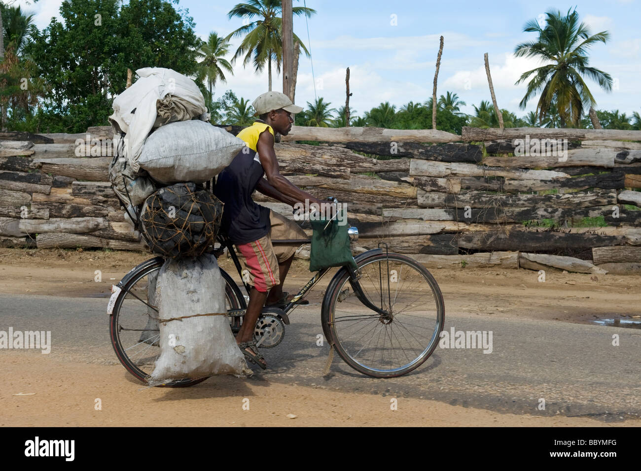 A man carrying bags with charcoal on his bicycle Quelimane Mozambique - Stock Image